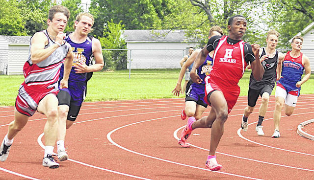 Hillsboro's Kai Rickman is pictured coming off the turn while winning the 200-meter dash in 22.68. He also won the district 100 meters and was on a winning relay team.