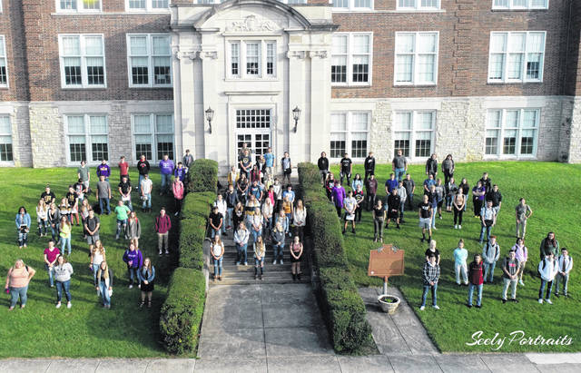 This year's McClain High School graduating class is pictured earlier in the school year in front of the high school.