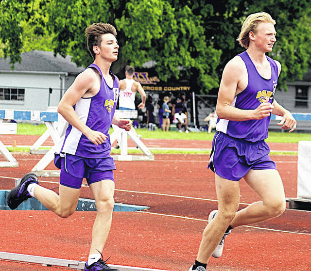 McClain's Jase Allison and Logan Scales compete in the 3200 meters last week at the Division II Southeast District Track and Field Meet held in Washington C.H.