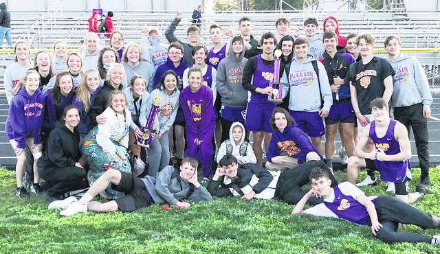 The McClain boys and girls track team are pictured Friday after winning the Bob Bergstrom Invitational at McClain Field in Greenfield.