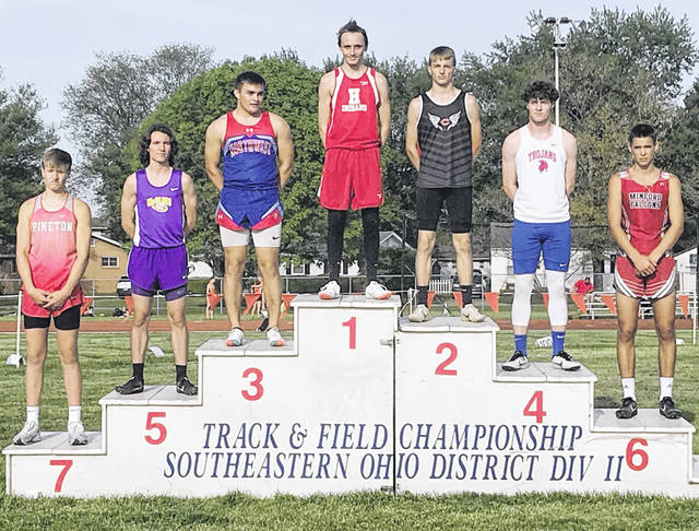 Hillsboro junior Anthony Richards won the long jump and was a member of the winning 4 x 200-meter relay team last week at the Division II Southeast District Track and Field Meet at Washington C.H. Also pictured is McClain's Trevor Caldwell who finished fifth in the long jump.