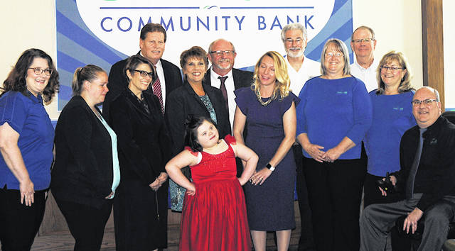 Highland County Society for Children and Adults Radio-Telethon Poster Child Elisha Duncan (front, center) is pictured with Southern Hills Community Bank employees and telethon representatives.