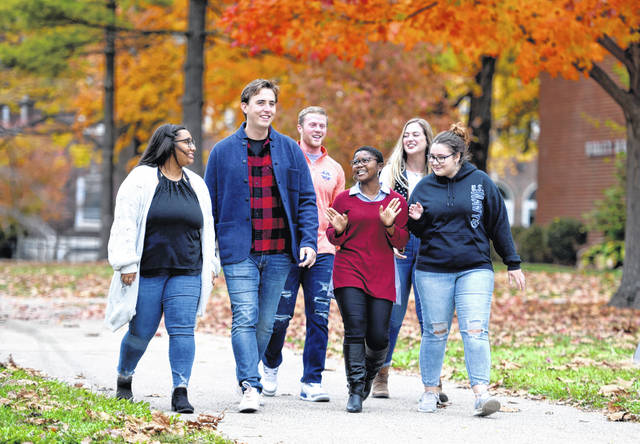 Students traverse Wilmington College's Collett Mall in fall 2019. New and returning students can expect a more robust campus experience should pandemic-related trends continue in the right direction.