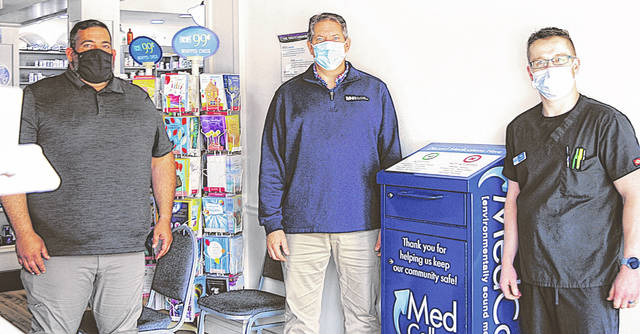 Pictured (l-r) are Bill Showman, Jeff Meyer and Nik Beatty standing next to a new Med Collect box inside Downtown Drug in Hillsboro.