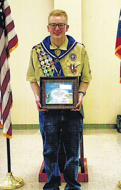 Logan Throckmorton is pictured with his Eagle Scout award.