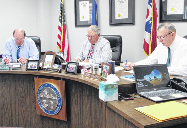 From left, David Daniels, Jeff Duncan and Terry Britton are shown during Wednesday's meeting of the Highland County Board of Commissioners.