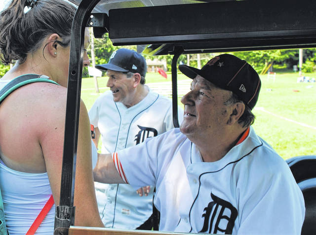 Kip Young (center) and Jon Warden (right) met with fans and signed autographs prior to the start of the KAMP Dovetail season-ending baseball game Thursday at Rocky Fork State Park. Young, a 1972 Whiteoak High School graduate, wore No. 37 as a starting pitcher for the Tigers for two seasons in 1978 and 1979. Warden, wearing No. 39, was a hard-throwing rookie lefthander when he played for the Tigers in 1968, the year the boys from the Motor City went all the way to win the '68 World Series against St. Louis.
