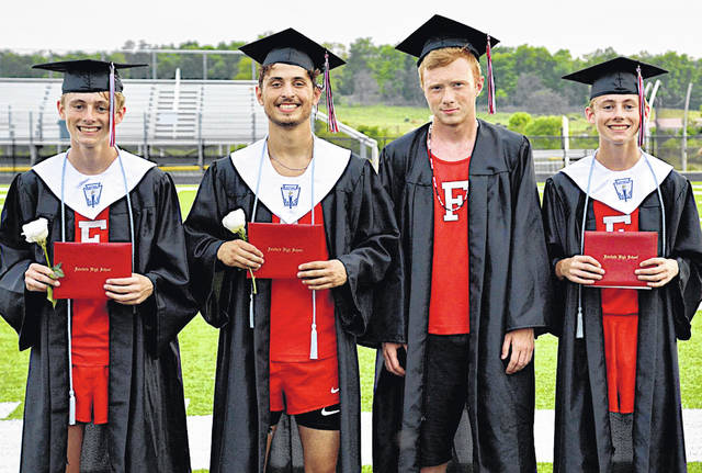 Wearing graduation gowns over their track and field uniforms, Fairfield High School seniors (in no particular order) Blake Haines, Ethan Kaiser, Nathan Vidourek and Brant Haines, are pictured last week at McDermott Northwest High School where they celebrated a special graduation.