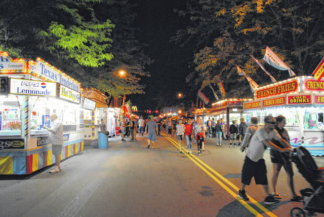 This is a nighttime photo of the midway from the Greenfield Rotary Club's 2019 Greene Countrie Towne Festival.