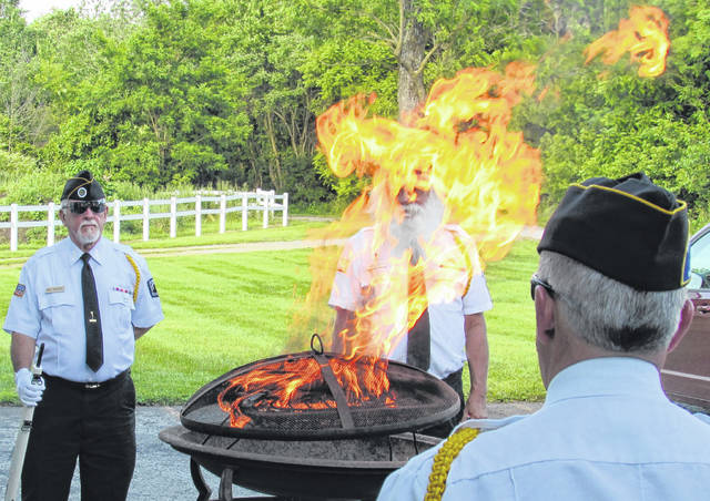 Hillsboro VFW Post 9094 hosted an annual flag retirement ceremony Monday evening in observance of Flag Day. Participating in Monday's proceedings were members of the Highland County Veterans Honor Guard, the Highland County Veterans Service Office, and representatives from both the Sons and Daughters of the American Revolution. Gary Duffield, president of the Highlanders Chapter of the Sons of the American Revolution, presented several awards Monday. Lt. Branden Jackman of Paint Creek Joint EMS/Fire District received the EMS Award; Highland County Common Pleas Court Judge Rocky was given the Law Enforcement Award; and Dep. Brett McMillan of the Highland County Sheriff's Office, though not able to attend Monday's ceremony, will be given the Life Saving Award. Gerold Wilkin of the Highland County Veterans Honor Guard was presented with a five-year pin for his membership in the local SAR, and John Buskey was newly inducted into the ranks of the Highland County SAR chapter. Hillsboro VFW Post Commander Rick Wilkin said that next year the flag retirement ceremony rotates each between the VFW and AmVets Post 61 on North Shore Drive in the Rocky Fork Lake area. Shown are members of the Highland County Veterans Honor Guard during Monday's flag retirement ceremony.