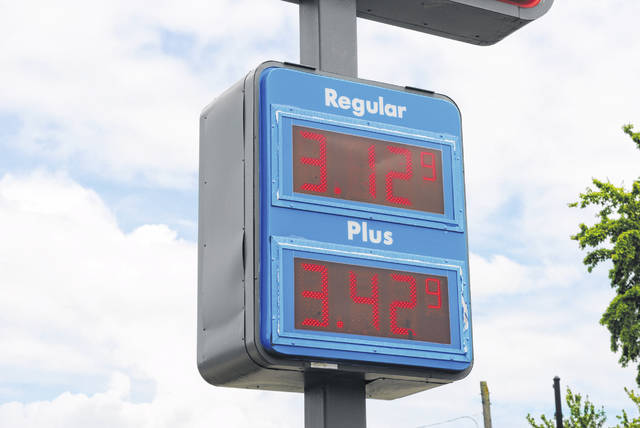 This is a picture of a sign showing gas prices Thursday at the United Dairy Farmers store in Hillsboro.