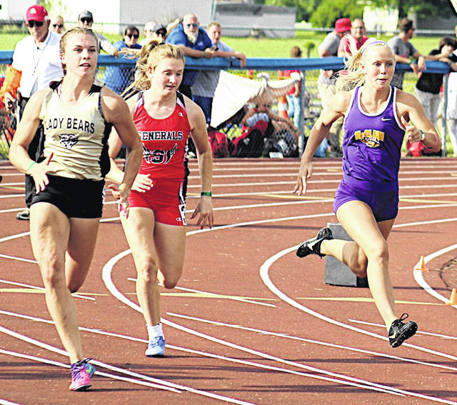 McClain's Kerrigan Pollard (far right) competes in the 100 meters at the regional track meet. The other girls are Kelsey Hartsock of River View and Julie Nichols of Sheridan.