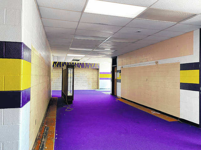McClain High School's gym lobby has been cleared as the district readies for the anticipated renovation of the space. The project, slated to begin soon, is expected to be completed by November.