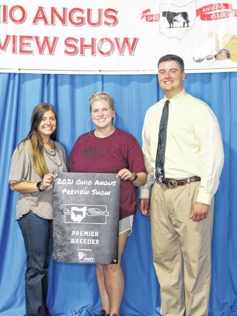 Maplecrest Farms in Hillsboro won premier breeder at the 2021 Ohio Angus Association Preview Show held June 20 in Washington C.H. Pictured from left are Kinsey Crowe, Lindsey Hall and Corbin Cowles, judge.