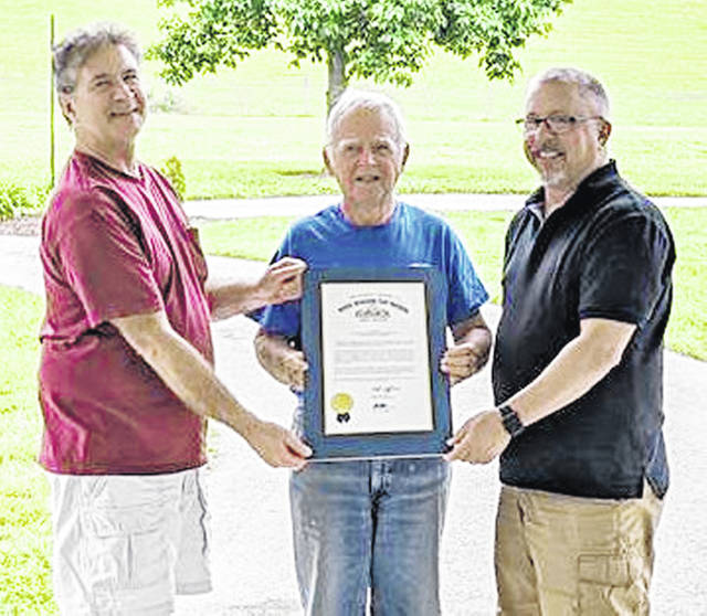 Pictured (l-r) are Highland Amateur Radio Association past president Jeff Collins, information officer John Levo and current president Pat Hagen with a proclamation the association recently received from the Ohio Senate.