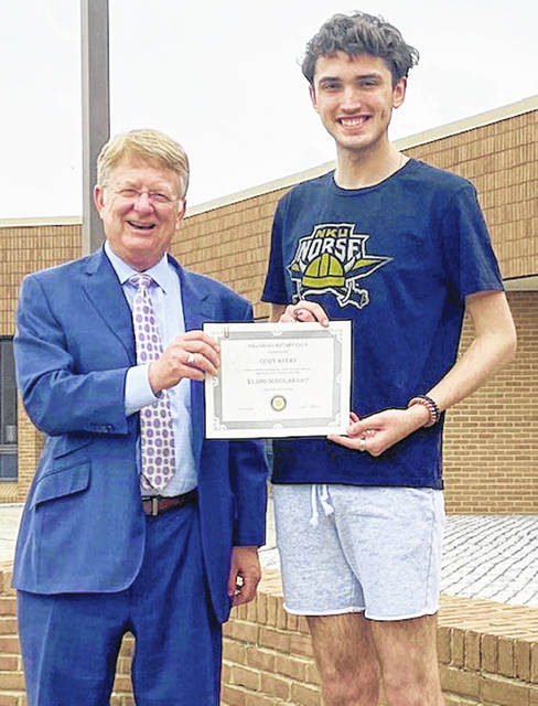 Rotary Scholarship Committee Chair Kevin Boys (left) presents a Rotary scholarship to Cody Ayers.