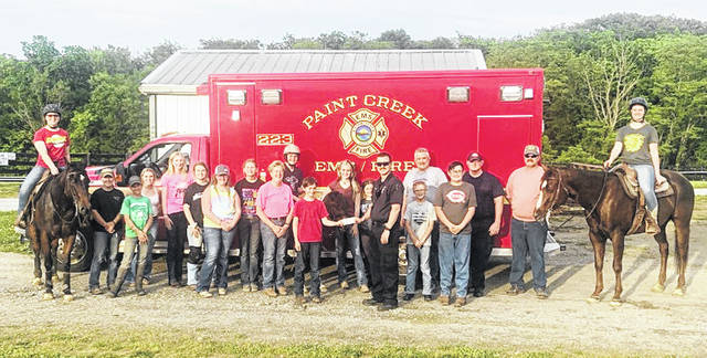 Members of the Silver Spurs 4-H Club are pictured with some of the people who helped make their May 16 horse show at the Highland County Fairgrounds a success. All proceeds went to the club. The club said it would like to thank everyone who helped.