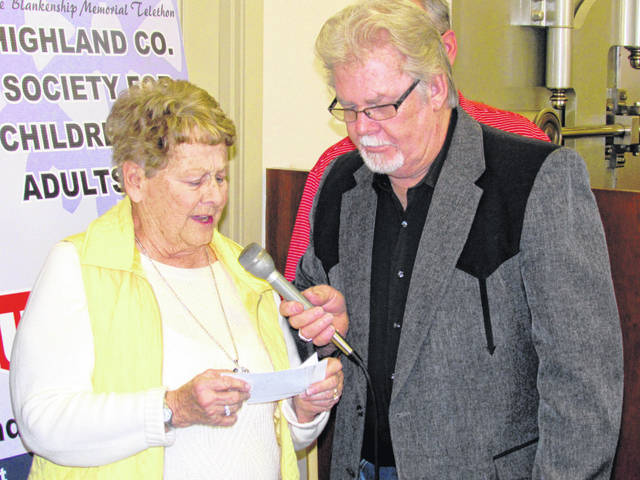 Emcee Herb Day (right) interviews Rita Blankenship, wife of the late radio-telethon namesake Ernie Blankenship, during a past event.