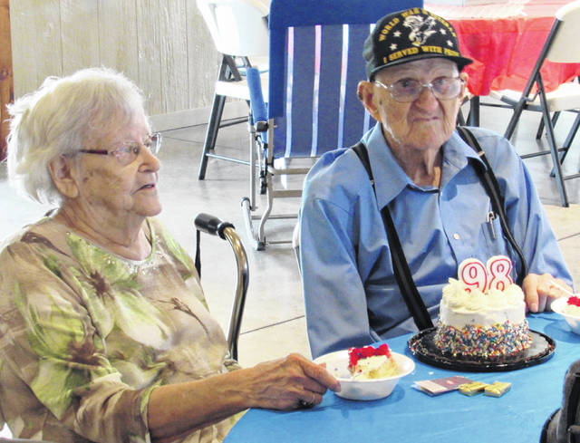 Nearly 200 well-wishers were on hand Sunday at the Creekview Barn venue near Samantha as the family of John and Virginia Howsman gathered to celebrate John's 98th birthday, which is Tuesday, June 15. Howsman is also a World War II veteran, having served 34 months in the U.S. Army with the 128th Anti-Aircraft Ammunition in Normandy, and also saw action in northern France and the Rhineland. He and his wife Virginia, who will turn 95 on Oct. 7, celebrated their 73rd anniversary on May 15. 2021