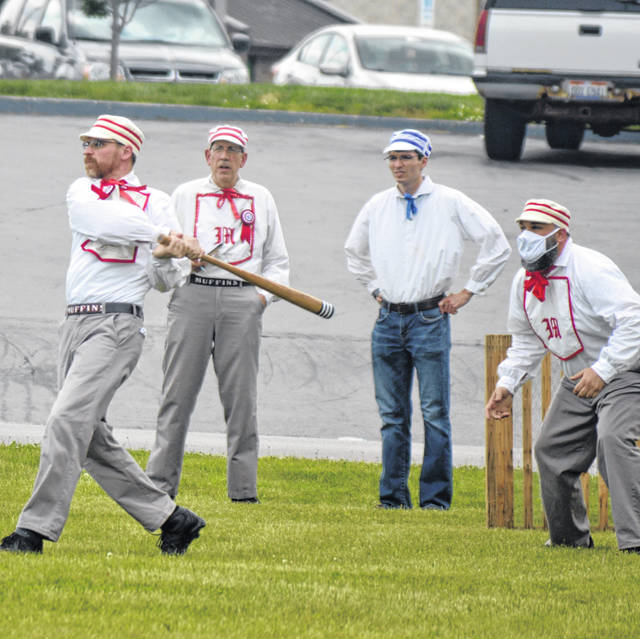 A member of the Columbus Muffins baseball team connects with a pitch in a game at the Armstrong Air & Space Museum in Wapakoneta.