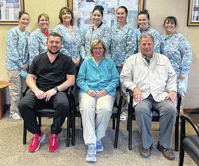 Drs. Philip Burwinkel and Ann Burwinkel McKenzie have announced the addition of Aaron Little, DDS, to Burwinkel Dentistry. Little (seated, left) is a 2013 graduate of Lynchburg-Clay High School and attended The Ohio State University for his under graduate degree. He is a graduate of The Ohio State University College of Dentistry. Little is the son of Rick and Julie Little of Lynchburg. Appointments can be made by calling 937-393-1634. The office staff is shown in this picture.