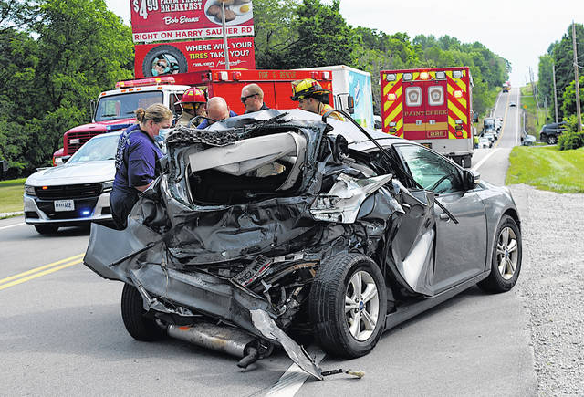 """A Hillsboro man was flown from Highland District Hospital to Grant Medical Center in Columbus Wednesday afternoon following this two-vehicle crash on U.S. Route 62 north of Hillsboro near Wright Road. According the Ohio State Highway Patrol Wilmington Post, Jarrod Page, 26, had been southbound and stopped to make a left turn onto Wright Road when his 2013 Ford Focus was rear-ended by a 2004 Peterbilt tractor-trailer owned by Palmer Farms and operated by Jamie Florence, 52, Hillsboro. The car was shoved a long distance down the road following the collision. The tractor trailer appeared to have minor damage to its front bumper and grill. Emergency personnel at the scene said Page got out of the vehicle by himself and was walking around and talking. However, the state patrol said Page suffered """"serious injuries"""" at the scene. He was transported by the Paint Creek Joint EMS/Fire District to HDH before being flown on. Florence was cited for failure to maintain an assured clear distance ahead."""