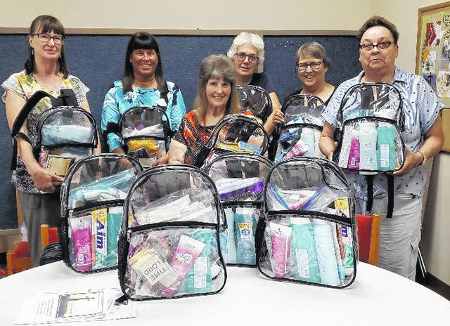 Members of the Highland County Christian Women are pictured with backpacks that will be delivered to the Highland County Jail.