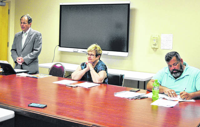 Bill Showman (right), Pat Friel (middle), owner of Friel and Associates, and Creed Culbreath deliberate during Wednesday's meeting of the Highland County Drug Abuse Prevention Coalition.