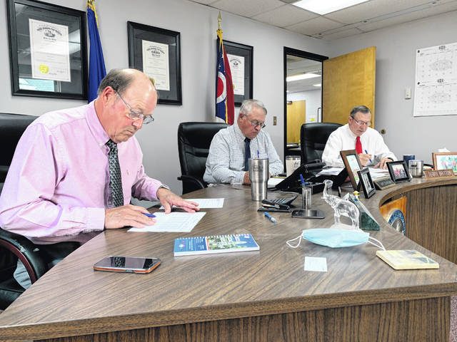 Highland County commissioners — from left, David Daniels, Jeff Duncan and Terry Britton — during their weekly Wednesday meeting.