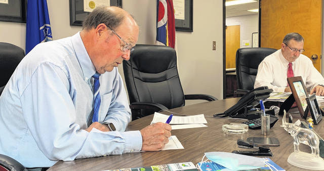 Highland County commissioners David Daniels (left) and Terry Britton are pictured during their weekly Wednesday meeting.