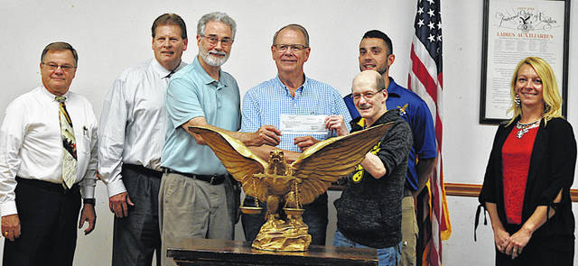 The Hillsboro Eagles made a $2,500 donation Tuesday to the 49th annual Ernie Blankenship Memorial Radio-Telethon for the benefit of the Highland County Society for Children and Adults. The donation brings the final total for the radio-telethon to $97,358, according to event organizer Rocky Coss. Pictured are event organizers, hosts, sponsors and Eagles members (l-r) Rocky Coss, Tim Priest, Ron Coffey, Rick Williams, Steve Purtee (front), Eli Hogsett (back) and Lindsay Cloud.