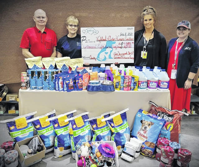 Pictured (l-r) are Barry Allen of AMES, Marilyn Rollwage with the Clinton County Humane Society, Penny Miller with the Highland County Humane Society, and Brianne Miller of Air Transport International.