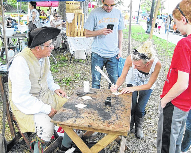 Scenes like this one of a Grassy Run Historical Arts Committee member displaying quill writing will be part of Pioneer Day on Aug. 14 at the Scott House in Hillsboro.