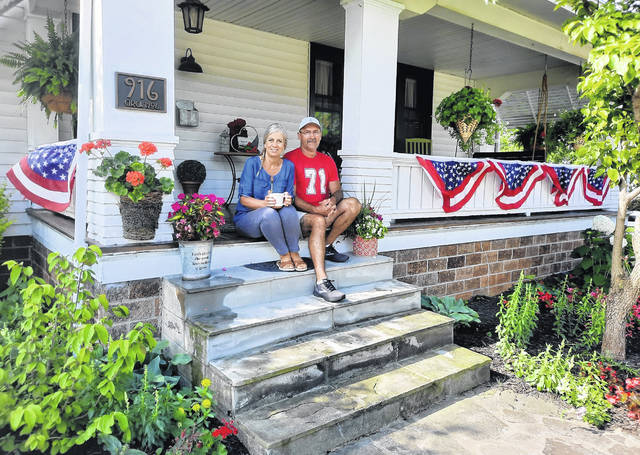 Faitha and Danny Shelton, winners of the Greenfield Most Patriotic Home Award, are pictured on the porch of their home at 916 Jefferson St.
