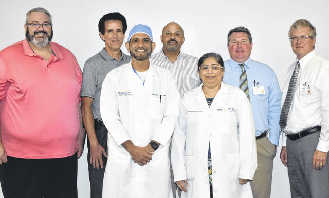 From left are: back row, Dr. Anthony Wetherington, Dr. David Gunderman, Dr. Craig McKinney, Tim Parry, Vice President of Operations, and Randy Lennartz, President and CEO; and, front, Dr. Naveed Haq and Dr. Poonam Singh.