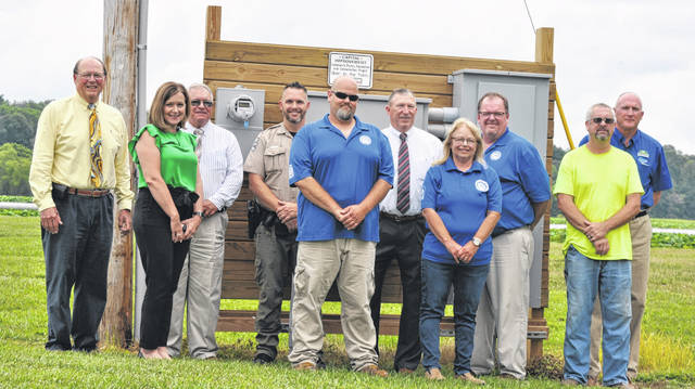 From left, David Daniels, Julie Bolender, Jeff Duncan, Cory Cover, Matt Lewis, Terry Britton, Debbie Daulton, Brian Miller, Tom Rhodes and Glen Cobb in front of the new electric area.