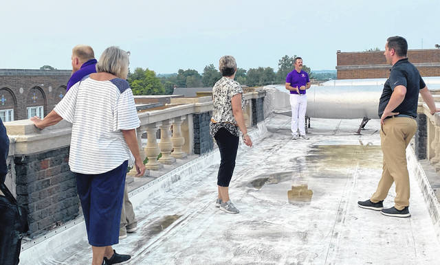 From left, school board members Charley Roman and Marilyn Mitchell, superintendent Quincey Gray, board member Eric Zint, and McClain Principal Matt Shelton are pictured as they stand on the High Bridge that connects the west side of McClain High School to the auditorium.
