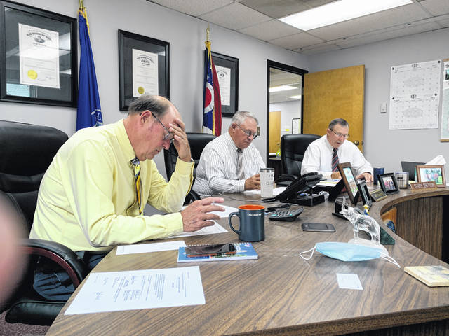 Highland County commissioners (l-r) David Daniels, Jeff Duncan and Terry Britton are shown during their weekly meeting Wednesday.