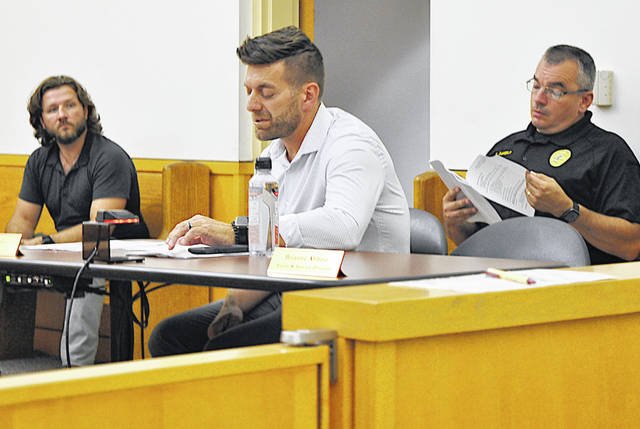 Hillsboro Mayor Justin Harsha (center) gives a report at Monday's city council meeting. Also pictured are Hillsboro Planning Commission Chair Rob Holt (left) and Hillsboro Police Chief Eric Daniels.