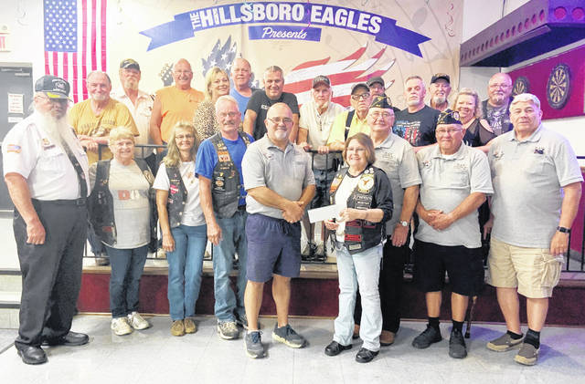 Members of the Eagles Riders 1161 are pictured making a $12,000 donation to DAV Lloyd C. Ludwick Chapter 123.