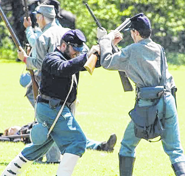 This is a scene from a Civil War battle re-enacted in May at the Red Oak Old West Town near Leesburg.