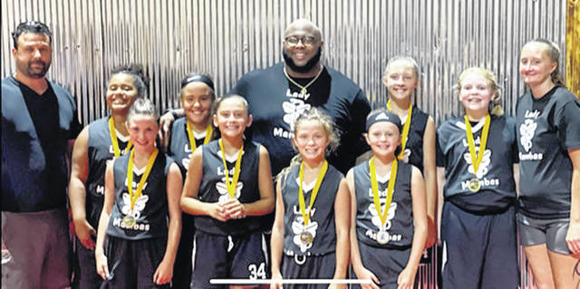 The Lady Mambas, a local girls third and fourth grade AAU team, recently went 8-4 in league play and captured first place in the Franklin AAU Tournament last Saturday and Sunday, beating the Cincy Shock and the Lebanon Warriors to earn the right to be the summer AAU champions. Pictured are (front row, l-r) Ella Howard, Jayonna Kibler, Madalynn Howard and Kylenn Legge; (back row, l-r) assistant coach Ethan Howard, Rylee Harper, Jayla Haithcock, head coach Derrik Haithcock, Tealyn Shriver, Emmalee Young and assistant coach Alisha. Not pictured are Alaina Schum, Emily Brill and Parker Wilkin.