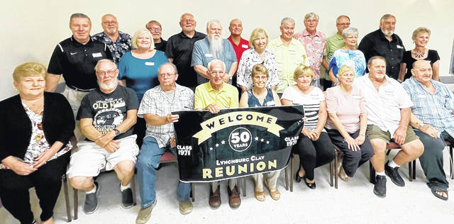 The Lynchburg-Clay High School class of 1971 celebrated its 50-year reunion Saturday, Aug. 21 at the Wilmington Eagles. Pictured are class members and one of their teachers who attended the reunion. Pictured (front row, l-r) are Mary Lou Barber Stockwell, Jim Cooper, Don Howard, E. Gene Cook (principal), Nancy Osborn Stegbauer, Cindy Mount Lukas, Sandra Osborn, Steve Walker and Charlie Kessinger; (back row, l-r) Mike Dyer, Jim Herdman, Joni Wells Minton, Kenny Eaglin, David Minton, Larry Brown, Bob Fawley, Nancy Hastings King, Terry Aber, Dave Gregory, Steve Stockwell, Patty Rhoades Malott, Glenn Bash and Sandy Collins McKee.