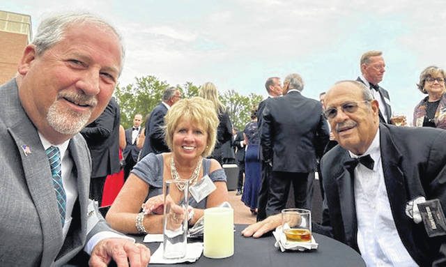 Greenfield residents Tom and Patty Smith (left) are pictured with Richard Patterson, a descendent of late Greenfield resident Frederick Patterson, during an Automotive Hall of Fame induction ceremony last month in Detroit, Michigan.