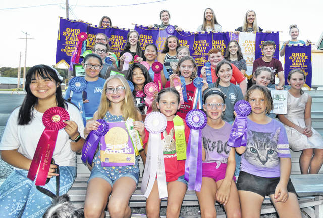 Some of the local 4-H members who won awards at the 2021 Ohio State Fair are pictured (top row, l-r) Haley Cornett, Marshall Stockmen; Carly Sanders, Premier Showmen; Sydney Sanders, Premier Showmen; Blake Herdman, All About Beef; Oakley Engle, Fur, Feathers and Friends; (fourth row, l-r) Andrea Kelch, Silver Spurs; Sydney Hamilton, Highland County Poultry, Pigs & Lambs; Marley Gobin, Concord Jr. Farmers; Trinity Edenfield, Highland's Best; Sam Hamilton, Highland County Poultry, Pigs & Lambs; (third row, l-r) Gage Thompson, Belfast Kids Unlimited; Emma Sanderson, Canine Commanders; Evelyn Roehm, Highland Harvesters; Hayden Stratton, Buford Diary & Livestock; (second row, l-r) Kaylei Sanderson, Canine Commanders; Jayah Chaney, Canine Commanders and Fantastics; Emelia Roehm, Highland Harvesters; Leah Robinson, Marshall Jr. Farmers; Eloise Roehm, Highland Harvesters; Kenley Juillerat, Concord Jr. Farmers; (front row, l-r) Kayah Chaney, Canine Commanders; Brynne Holsted, Highland County Unlimited; Annabelle Thompson, Belfast Kids Unlimited; D'lelah Laber, Marshall Stockmen; McKayla Wilder, Belfast Kids Unlimited.