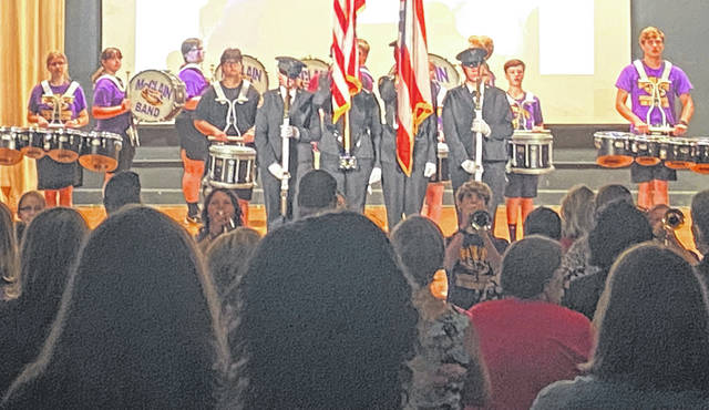 The McClain Marching Band and McClain Cadet Corps are pictured during the national anthem at the Greenfield Exempted Village School District's opening session for staff.