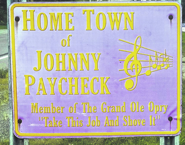 This faded tribute to Johnny Paycheck sits at an entrance to his hometown of Greenfield.