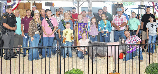 The Grand Champion Market Hog exhibited by Oakley Engle sold for $17.40 per pound Wednesday at the Highland County Fair. It was purchased by Dr. Jeff Berry, Olan and Glenna Engle, Faith's Fancy Feeds, Fordyce Farms & Southern Ohio Retro Foam, Keith's Drywall, Kiley Construction & Excavation, Lewis Financial Group, David & Lesia McKenna, Cornerstone Vet Service, Dr. Bruce Fredrick, NCB, Old Y Restaurant LLC, Parry Show Cattle, Richmond Concrete, Roberts Paving, Inc., Dr. James McKown DDS, Mt. Orab Vet Clinic, Greg Maynard, Keplinger Farms, Merchants National Bank Hillsboro, Michael's Construction, Simmons Show Lambs, Justin Newell for Whiteoak Township Trustee, Sonner's Family Show Pigs, Sheriff Donald Barrera, Swamp Road Cattle Co., Aaricks Propane, Shana Reffitt, Brandon and Nicole Stratton, Mark Edenfield Poured Walls, Grant Edenfield, Sponcil Farms and Richmond Concrete.