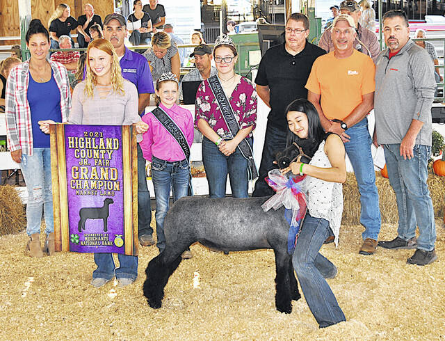 Sophie Young's Grand Champion Market Lamb was sold for $10.75 per pound Friday at the Highland County Fair. It was purchased by Jim Mootz Trucking, Shelly Materials, Fayette Veterinary Hospital, Scott Faulconer State Farm, Tim Boler Home Inspections and Jeff Boler.