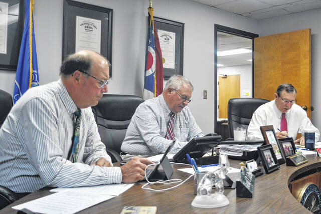Highland County commissioners (l-r) David Daniels, Jeff Duncan and Terry Britton, are pictured during their weekly Wednesday meeting.